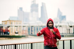 A black man runner with earphones