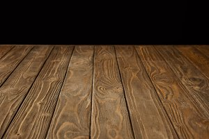 empty wooden tabletop isolated on bl