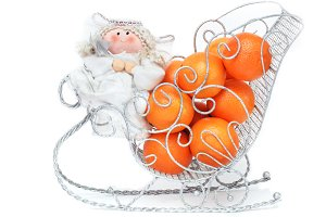 Toy angel with tangerines