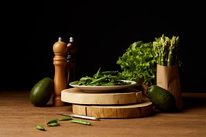 row green vegetables on wooden surfa