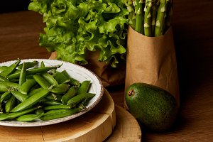 healthy green vegetables on wooden t