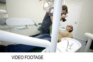 Dentist making photo of patients
