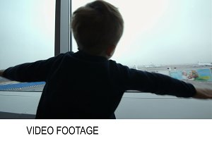 Little boy showing plane with hands