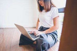 Asian women relax playing laptops ha