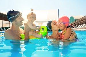 Happy family having fun by the