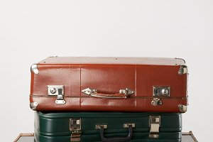 Vintage leather suitcases on wooden