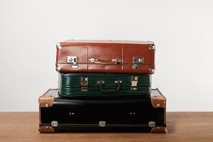 Stacked old leather travel bags on w