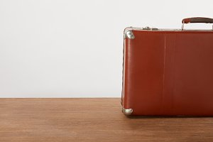 Vintage leather suitcase on wooden t
