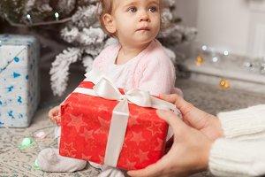 A beautiful cute little girl opens a