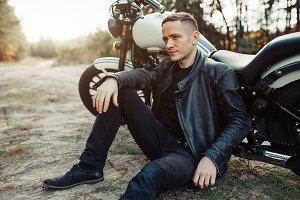Handsome rider guy in black biker ja