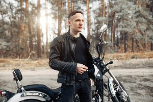 Handsome rider guy in black biker ja