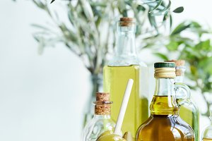 glass with spoon and green olives, v