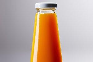 bottle of fresh orange juice on refl
