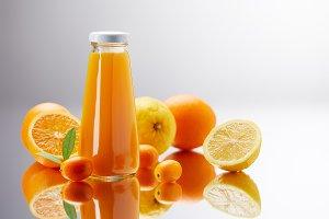 bottle of fresh juice with oranges,