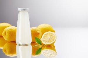 glass bottle of fresh lemonade with