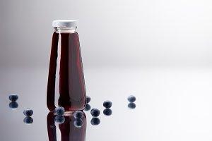 glass bottle of fresh blueberry juic