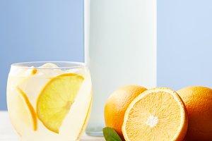 glass and bottle of orange lemonade