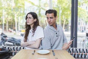 Woman upset to her boyfriend sitting
