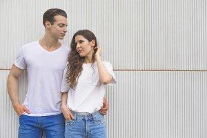 Young beautiful couple posing wearin