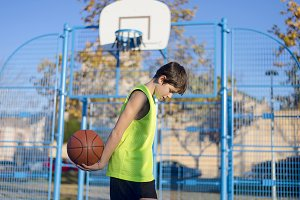 Young basketball player standing on