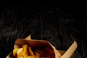 Golden french fries in craft paper o