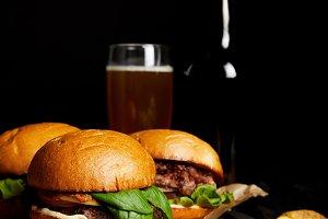 Set of junk food hamburgers on table