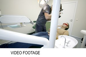 Dentist taking pictures of womans