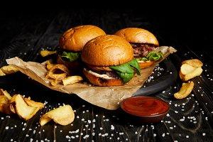 Tasty hamburgers and french fries wi