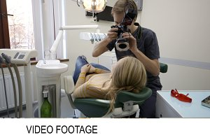 Dentist making shots of womans smile