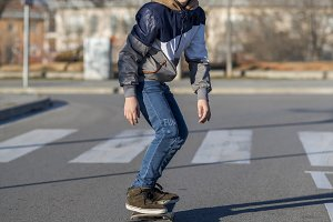 Young man riding on a skate in the c