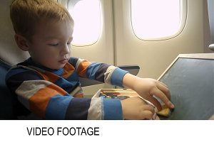 Little boy in the plane with wooden