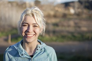 Active cheerful blonde pausing after