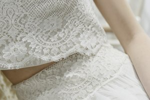 Cropped view of bride in lace dress