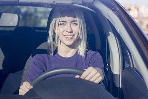 Beautiful Smiling woman driving car,