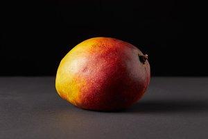 fresh raw of mango on black backgrou