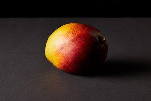fresh ripe mango on black background