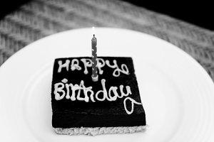A small square chocolate birthday ca