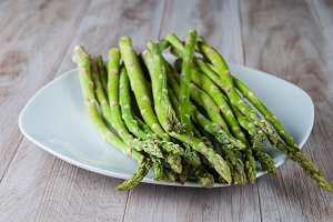 Fresh Asparagus on White Plate