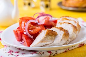 Grilled chicken with tomato salad
