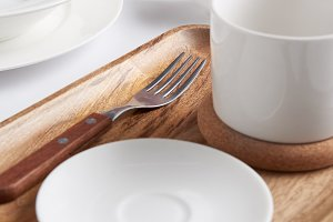selective focus of wooden tray, fork