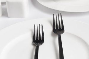 close up view of forks, various plat