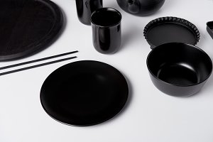 selective focus of black plate, bowl