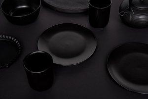 selective focus of black teapot, bow