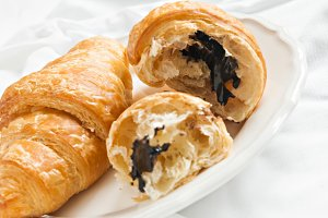 croissant with chocolate is broken c