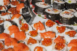 many homemade rolls and sushi close-