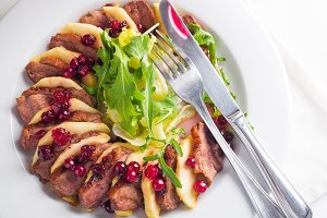 Salad with slices of duck breast