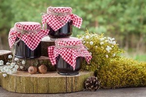 Jars of jam and rustic decoration