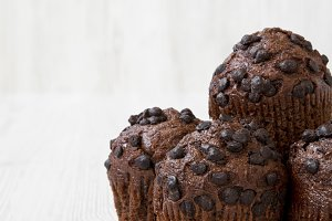 Chocolate muffins on white wooden