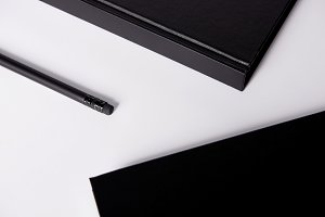 close-up shot of black notebooks wit