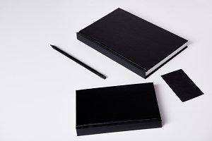 close-up shot of black notebooks  on